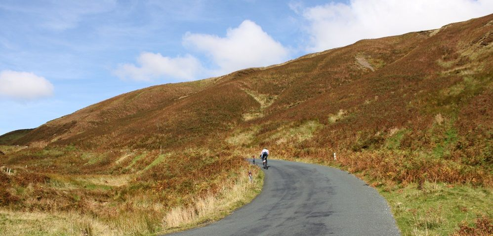 Cyclist climbing up the Trough of Bowland